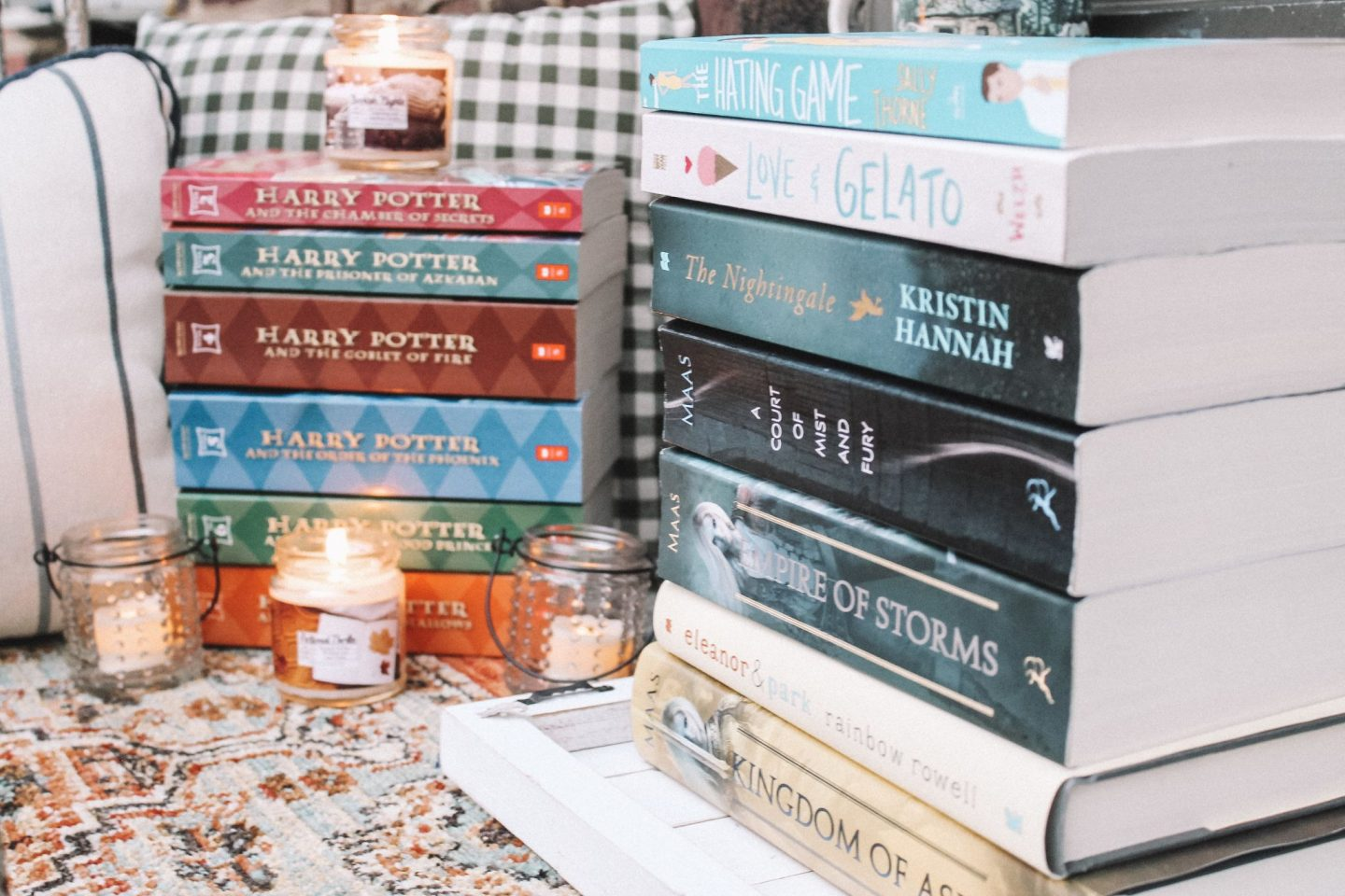 roses, flowers, bookstack, young adult, fantasy, ya, girl reading, woman reading, fire escape, reading on fire escape, books, young adult, flowers, candles, bookish candles, cozy while reading, bookworm, harry potter, gryffindor, sarah j. maas, throne of glass, kingdom of ash, j.k rowling, reading on fire escape, reading in new york, New York, nyc.